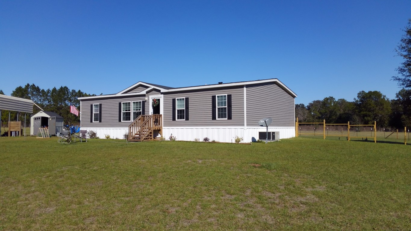 SOLD! Almost new 4/2, over 7 acres
